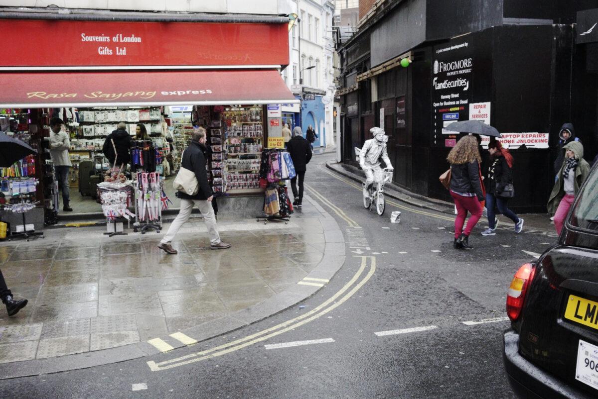 White Cyclist on Oxford St by Michael Wayne Plant